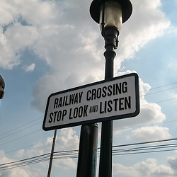 Strasburg, PA, USA - September 30, 2014: A Railway crossing sign. Stop look and listen.