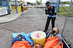 © Licensed to London News Pictures. 22/05/2021. Oldham, UK. Police speak to Animal Rebellion activists at the Heywood Distribution Park in Oldham, which supplies hundreds of McDonald's restaurants in the region. The animal rights group are demanding that McDonald's commit to a fully plant-based operation by 2025. Photo credit: Adam Vaughan/LNP