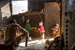 Niruta cooks breakfast for Durga and their kids before they go to school. <br /> <br /> Niruta and Durga were married 9 years ago, when they were just 14 and 16 years old in the Kagati village of Nepal. The 2015 earthquakes devastated Nepal and left girls and women in an increasingly vulnerable position, leading experts to believe child marriage rates will increase over the coming years.