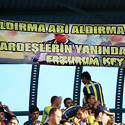 "Fenerbahce's suppoters showing the flag ""Your brothers with you from Erzurum"" during their Turkish Super Cup 2012 soccer derby match Galatasaray between Fenerbahce at the Kazim Karabekir stadium in Erzurum Turkey on Sunday, 12 August 2012. Photo by TURKPIX"