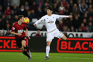 Ki Sung-Yueng of Swansea city (r) looks to go past  Jonny Evans of West Brom (l). Barclays Premier league match, Swansea city v West Bromwich Albion at the Liberty Stadium in Swansea, South Wales  on Boxing Day Saturday 26th December 2015.<br /> pic by  Andrew Orchard, Andrew Orchard sports photography.