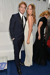 SAM CLAFLIN and LAURA HADDOCK at the Glamour Women of The Year Awards in Association with Next held in Berkeley Square Gardens, Berkeley Square, London on 3rd June 2014.