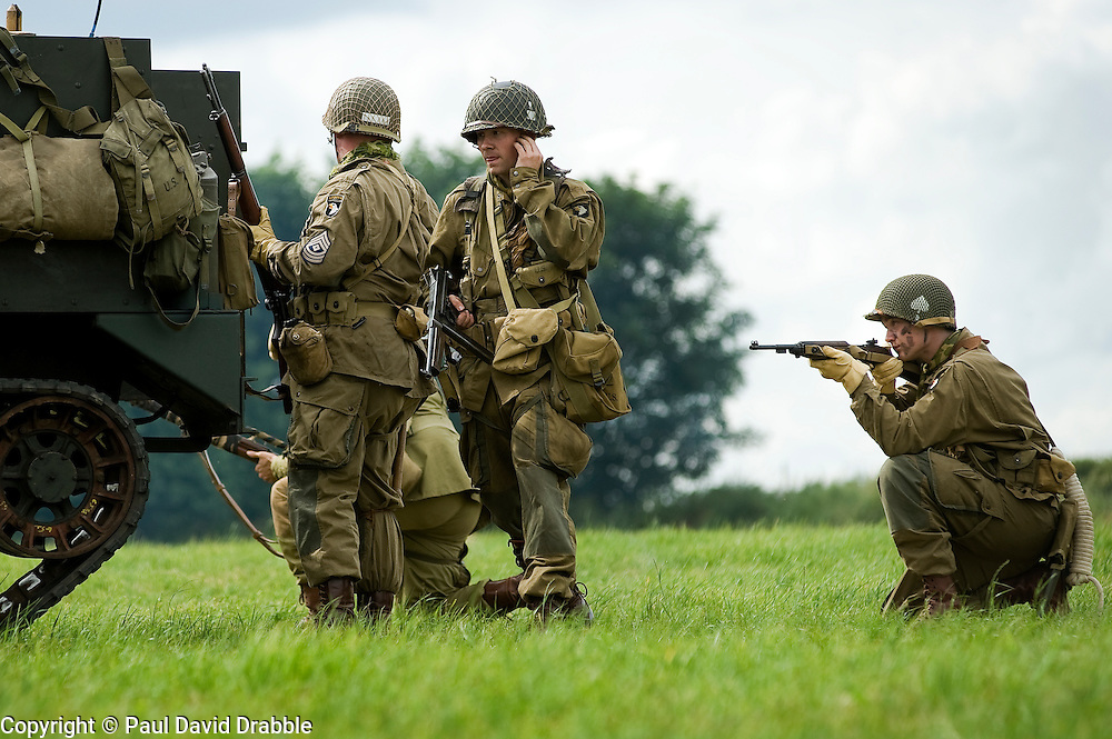 """Re-enactors from the Northern World War Two Association Living History group portraying the American 101st Airborne """"Screaming Eagles"""" advancing during a large scale battle re-enactment. SPAM 1940's Weekend. Heckmonwyke near Wakefield 10 July 2010 .Images © Paul David Drabble"""