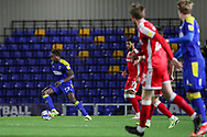 AFC Wimbledon midfielder George Dobson (24) dribbling during the EFL Sky Bet League 1 match between AFC Wimbledon and Gillingham at Plough Lane, London, United Kingdom on 23 February 2021.