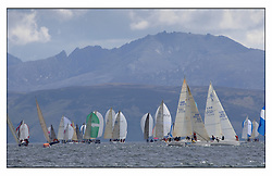 The final days racing at the Bell Lawrie Yachting Series in Tarbert Loch Fyne. The overall winners were decided in most classes on the last days racing..J109 Jeronimo leads Quokka across the top reach in Class 2's Fleet as they race under Arran.