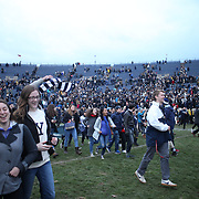 NEW HAVEN, CONNECTICUT - NOVEMBER 18: Yale fans celebrate victory during the Yale V Harvard, Ivy League Football match at the Yale Bowl. Yale won the game 24-3 to win their first outright league title since 1980. The game was the 134th meeting between Harvard and Yale, a historic rivalry that dates back to 1875. New Haven, Connecticut. 18th November 2017. (Photo by Tim Clayton/Corbis via Getty Images)