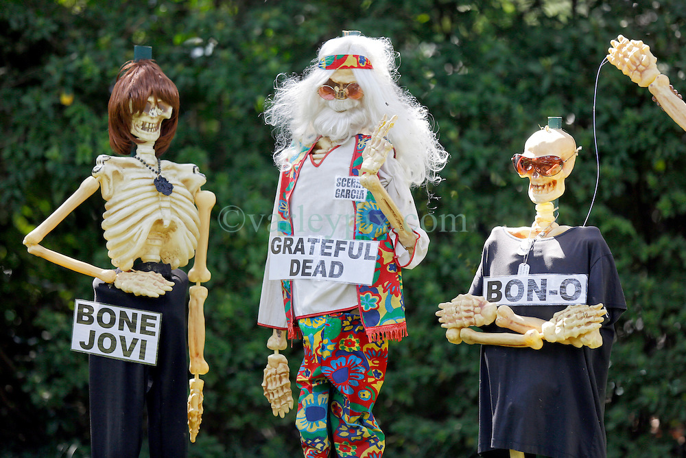 30 October 2015. New Orleans, Louisiana.<br /> The Skeleton Krewe mansion on St Charles Avenue at the corner of State Street draws crowds with its satirically spooky Halloween decorations. Muisicians Bon Jovi, Jerry Garcia, and Bono are depicted as 'Bone jovi, Grateful Dead, Bon-o, Trom-bone Shorty and Bone-y Raitt.<br /> Photo©; Charlie Varley/varleypix.com