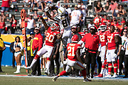 Los Angeles Chargers wide receiver Mike Williams (81) is covered by Kansas City Chiefs cornerback Steven Nelson (20) and Kansas City Chiefs cornerback Eric Murray (21) as he leaps and tries to catch an incomplete sideline pass during the 2018 regular season week 1 NFL football game against the Kansas City Chiefs on Sunday, Sept. 9, 2018 in Carson, Calif. The Chiefs won the game 38-28. (©Paul Anthony Spinelli)