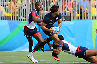August 09, 2016; Rio de Janeiro, Brazil; USA Men's Eagles Sevens Perry Baker and Maka Unufe tackle against Argentina during the Men's Rugby Sevens Pool A match on Day 4 of the Rio 2016 Olympic Games at Deodoro Stadium. Photo credit: Abel Barrientes - KLC fotos