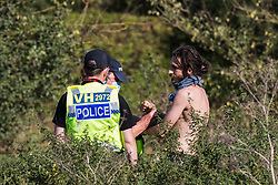 West Hyde, UK. 14th September, 2020. Hertfordshire Police officers arrest an environmental activist from HS2 Rebellion who had been observing other activists blocking a gate to the South Portal site for the HS2 high-speed rail link. Anti-HS2 activists used lock-on arm tubes to block two gates to the same works site for the controversial £106bn rail link, one remaining closed for over six hours and another for over nineteen hours.