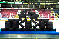 KELOWNA, CANADA - OCTOBER 3:  Hockey pucks stand on the boards for warm up between the Kelowna Rockets and the \Tri-City Americans on October 3, 2018 at Prospera Place in Kelowna, British Columbia, Canada.  (Photo by Marissa Baecker/Shoot the Breeze)  *** Local Caption ***