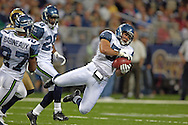 Seattle linebacker Lofa Tatupu (51) intercepts St. Louis quarterback Marc Bulger during the third quarter at the Edward Jones Dome in St. Louis, Missouri, October 9, 2005.  Seattle beat St. Louis 37-31.