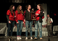"""The Sagacious Spellerzzz Cassie Sousa, Kaitlyn Brooks, Delia Cormier and Allyssa Miner take home the trophy during the LHS Spelling Bee Thursday evening with the word """"perspicacious"""".   (Karen Bobotas/for the Laconia Daily Sun)"""