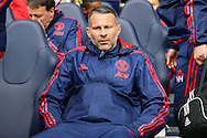 Ryan Giggs, the Manchester United Coach looks on while sitting in the dugout before k/o. Barclays Premier league match, Tottenham Hotspur v Manchester Utd at White Hart Lane in London on Sunday 10th April 2016.<br /> pic by John Patrick Fletcher, Andrew Orchard sports photography.