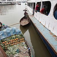 A small boat sells pineapples on the Buriganga river, Dhaka, Bangladesh