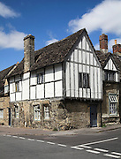 Black and white, wooden framed historic building, Lacock, Wiltshire, England