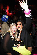"""r to l: Jaselene Gonzalez and Guest at The YRB Magazine's """" How You Rock It 3 """" with a special performance by Busta Ryhmes and hosted by YRB held at M2 Lounge on May 19, 2009 in New York City."""