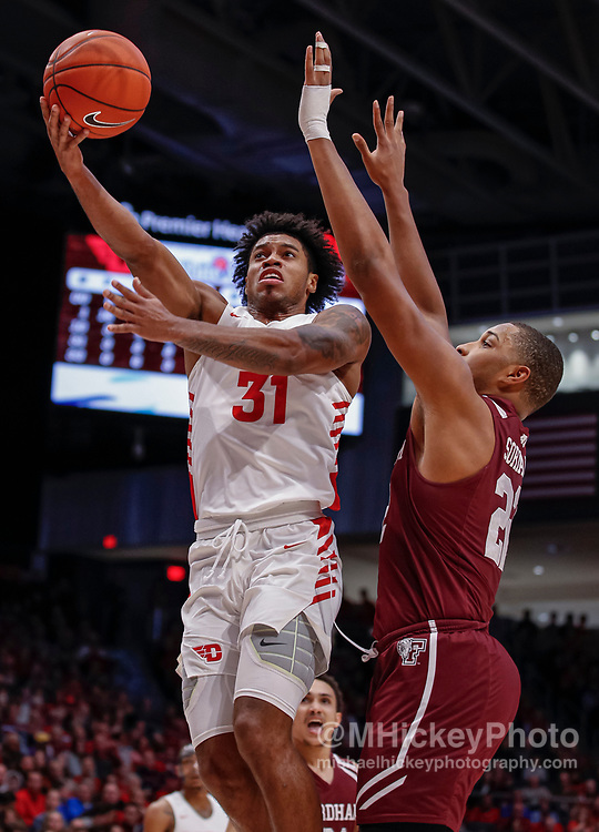 DAYTON, OH - FEBRUARY 01: Jhery Matos #31 of the Dayton Flyers shoots the ball against Joel Soriano #22 of the Fordham Rams during the second half at UD Arena on February 1, 2020 in Dayton, Ohio. (Photo by Michael Hickey/Getty Images) *** Local Caption *** Jhery Matos; Joel Soriano