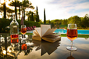 Wine poured and a book to read in front of the pool in a country holiday house, 25th August 2014, Lagrasse France.