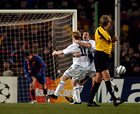 Photo. Jed Wee.<br /> FC Barcelona v Chelsea, UEFA Champions League, 23/02/2005.<br /> Chelsea's Damien Duff celebrates with Joe Cole as Barcelona's Juliano Belletti slumps after scoring an own goal.
