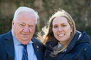 Merrick, New York, USA. April 8, 2017.  New York State Senator John E. Brooks (D - 8th Dist) and Sue Moller, of Merrick, pose at Eggstravaganza annual community celebration, hosted by North Merrick Civic Association and American Legion Auxiliary Merrick Post 1282, with Easter Egg Hunts, balloons, and other outdoor family fun.