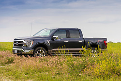 """2021 Ford F150 King Ranch with 20"""" wheels and Chrome Appearance package and Smoked Quartz paint."""