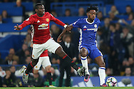 Michy Batshuayi of Chelsea is intercepted by Paul Pogba of Manchester United. Premier league match, Chelsea v Manchester Utd at Stamford Bridge in London on Sunday 23rd October 2016.<br /> pic by John Patrick Fletcher, Andrew Orchard sports photography.