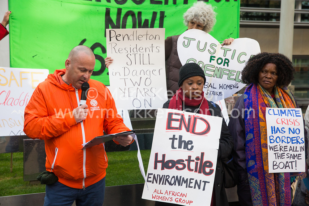 London, UK. 17 October, 2019. Graeme Langton of the Pendleton estate in Salford addresses campaigners from Fuel Poverty Action (FPA), residents in uninsulated homes and climate activists protesting outside the Ministry of Housing, Communities and Local Government (MHCLG) before delivering a letter signed by FPA, 80 organisations, trade unions and MPs in just ten days precisely one year after a strongly worded letter about the urgency of recladding flammable buildings and insulating those that are cold was delivered to the Government department. Commitments made by the MHCLG in response to the original letter have not been met. Credit: Mark Kerrison/Alamy Live News