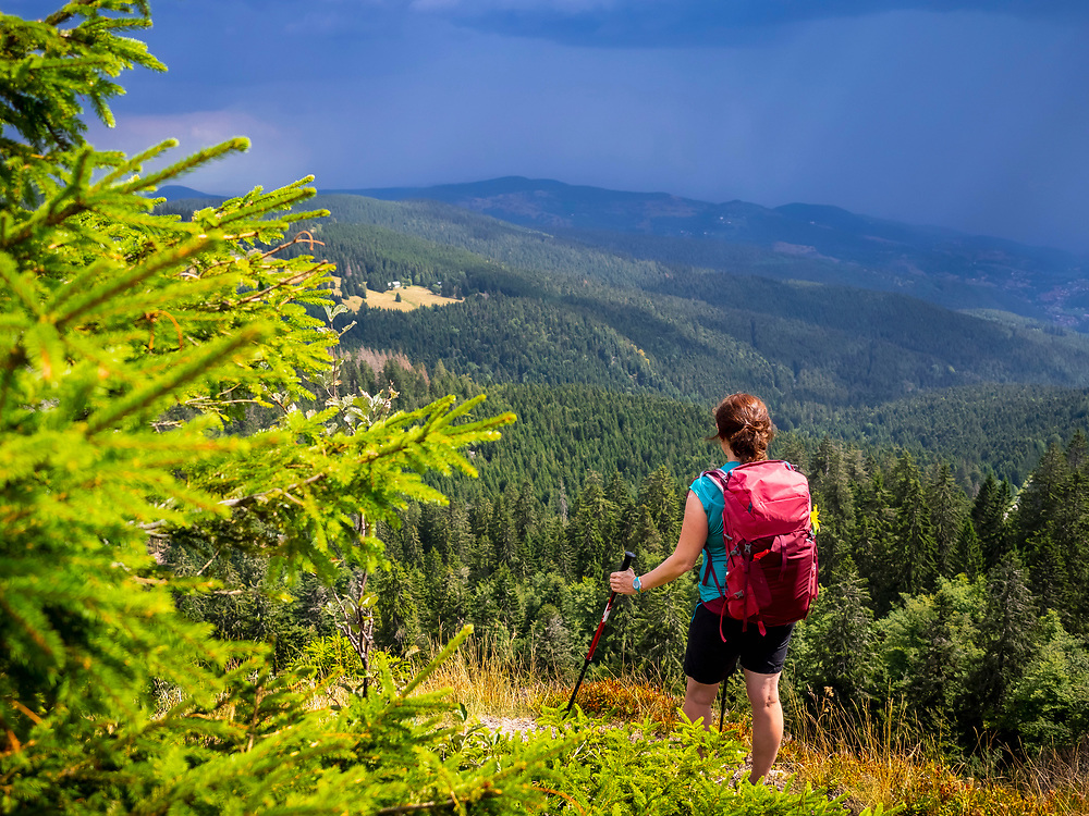 Women hiker looking at view of mountain landscape at Col de la Schlucht In the Vosges, Alsace, France