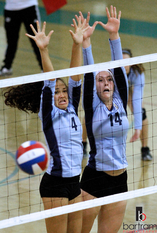 Heritage High School's Brileigh Boyce, left, and Melissa Shatswell go up to block a shot from Deer Valley during their match at Deer Valley High School on Tuesday, Oct. 11, 2011 in Antioch. (Photo by Kevin Bartram)
