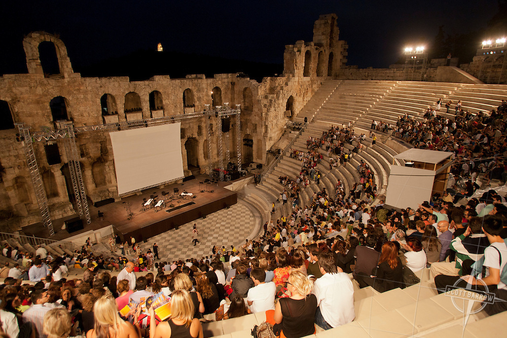 Odeon of Herodes Atticus at the foot of the Acropolis.  Phillip Glass performance with vintage film of Beauty and the Beast by Jean Coteau (1946 film).