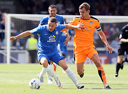 Conor Washington of Peterborough United holds off Colchester United's Alex Gilbey - Mandatory byline: Joe Dent/JMP - 07966386802 - 15/08/2015 - FOOTBALL - ABAX Stadium -Peterborough,England - Peterborough United v Colchester United - Sky Bet League One