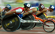 Sep 1, 2007; Osaka, JAPAN; Competitors are a blur in the wheelchair 1,500m  in the 11th IAAF World Championships at Nagai Stadium.