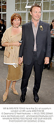 MR & MRS PETE TONG he is the DJ, at a party in London on 8th June 2002.<br />PAS 58
