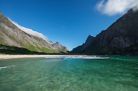 Azure colored arctic water of Horseid beach, Moskenesøy, Lofoten Islands, Norway