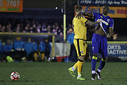 Sutton United Dean Beckwith (4) gets shirty with AFC Wimbledon striker Tom Elliott (9) during the The FA Cup third round replay match between AFC Wimbledon and Sutton United at the Cherry Red Records Stadium, Kingston, England on 17 January 2017. Photo by Stuart Butcher.