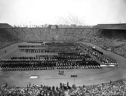 The teams lined up during the opening ceremony of the Olympic Games as 2500 pigeons are released at Wembley.