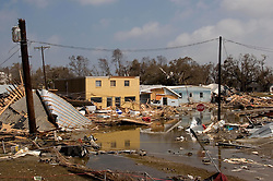 25 Sept, 2005. Cameron, Louisiana. Hurricane Rita aftermath. <br /> The destroyed remains of  downtown business in Cameron, Louisiana two days after the storm ravaged the small town.<br /> Photo; ©Charlie Varley/varleypix.com