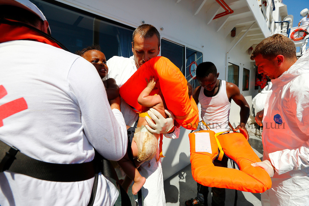 Migrant babies are brought onto the Migrant Offshore Aid Station (MOAS) ship MV Phoenix after being rescued from an overloaded wooden boat off the coast of Libya August 6, 2015.  An estimated 600 migrants on the boat were rescued by the international non-governmental organisations Medecins san Frontiere (MSF) and MOAS without loss of life on Thursday afternoon, a day after more than 200 migrants are feared to have drowned in the latest Mediterranean boat tragedy after rescuers saved over 370 people from a capsized boat thought to be carrying 600.<br /> REUTERS/Darrin Zammit Lupi <br /> MALTA OUT. NO COMMERCIAL OR EDITORIAL SALES IN MALTA