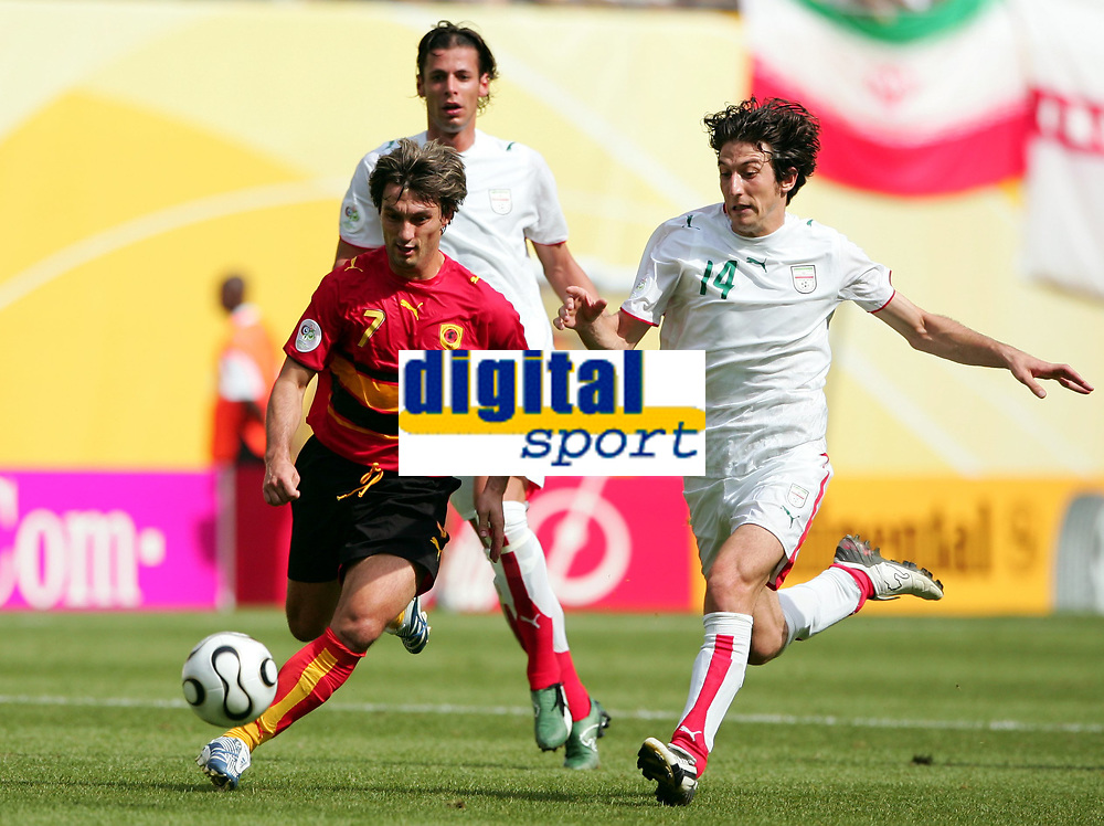 Fotball<br /> VM 2006<br /> Foto: Dppi/Digitalsport<br /> NORWAY ONLY<br /> <br /> FOOTBALL - WORLD CUP 2006 - STAGE 1 - GROUP D - IRAN v ANGOLA - 21/06/2006 - JOSE FIGUEIREDO (ANG) / ANDRANIK TEYMOURIAN (IRAN)