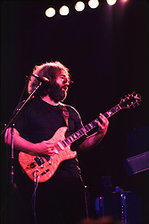 Jerry Garcia performing with the Grateful Dead in Concert at the Huntington Civic Center, Huntington West Virginia on 16 April 1978. Image No. 78C16-17