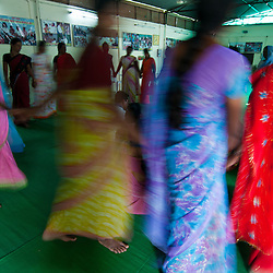 VHWs dance and sing during a training session at the CRHP compound.  The training sessions are more than just education, they are a community of empowered women dealing with the problems of their villages.