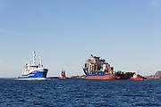 The hull Rem Ocean under towing from Kleven Ulsteinvik to Kleven Myklebust in Gurskebotnen, Norway. Passing the vessel Havsnurp | Skroget Rem Ocean under tauing fra Kleven Verft i Ulsteinvik, til Kleven Myklebust i Gurskebotnen. Passerer ringnotsnurparen Havsnurp.