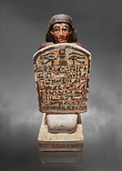 Ancient Egyptian Stelophorus statue of Amenemipet, limestone, New Kingdom, 18th Dynasty, (1539-1292 BC), Deir el Medina, tomb of Ibu. Egyptian Museum, Turin. Cat 3038. Grey background .<br /> <br /> If you prefer to buy from our ALAMY PHOTO LIBRARY  Collection visit : https://www.alamy.com/portfolio/paul-williams-funkystock/ancient-egyptian-art-artefacts.html  . Type -   Turin   - into the LOWER SEARCH WITHIN GALLERY box. Refine search by adding background colour, subject etc<br /> <br /> Visit our ANCIENT WORLD PHOTO COLLECTIONS for more photos to download or buy as wall art prints https://funkystock.photoshelter.com/gallery-collection/Ancient-World-Art-Antiquities-Historic-Sites-Pictures-Images-of/C00006u26yqSkDOM