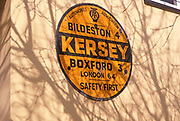 A87DGB Old yellow road sign giving distances Kersey Suffolk England