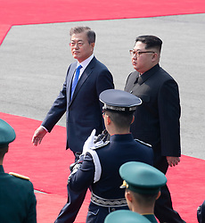 April 27, 2018 - Panmunjom, South Korea - South Korean President MOON JAE-IN meets North Korean leader (DPRK) KIM JONG UN, as he crosses the concrete step and the world's most heavily armed border to greet the South Korean President. (Credit Image: © Inter-Korean Press Corps via ZUMA Wire)