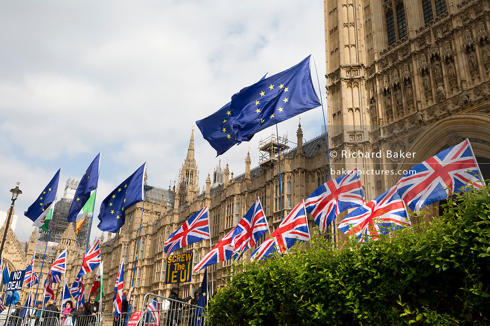 As MPs decide on how to progress with Brexit parliamentary procedure, EU and Union Jack flags fly outside the UK Parliament in Westminster, on 28th March 2019, in London, England