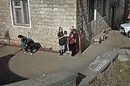 Stepanakert residents talking in the yard of the block apartments complex..