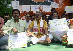 May 4, 2017 - Kolkata, West Bengal, India - Bharatiya Janta Party state president, Dilip Ghosh(in center) joins this protest rally in Kolkata. Bharatiya Janta Party Yuva Morcha hold a protests in College Square accusing ruling Trinamool Congress  for forcing  Naxalbari tribal couple who had hosted B.J.P. president Amit Shah during his recent visit, to Trinamool Congress. (Credit Image: © Saikat Paul/Pacific Press via ZUMA Wire)