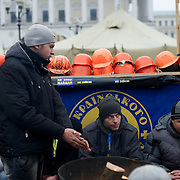 December 19, 2013 - Kiev, Ukraine: Pro-EU demonstrators try to stay warm beside a fire in Independence Square.<br /> On the night of 21 November 2013, a wave of demonstrations and civil unrest began in Ukraine, when spontaneous protests erupted in the capital of Kiev as a response to the government's suspension of the preparations for signing an association and free trade agreement with the European Union. Anti-government protesters occupied Independence Square, also known as Maidan, demanding the resignation of President Viktor Yanukovych and accusing him of refusing the planned trade and political pact with the EU in favor of closer ties with Russia.<br /> After a days of demonstrations, an increasing number of people joined the protests. As a responses to a police crackdown on November 30, half a million people took the square. The protests are ongoing despite a heavy police presence in the city, regular sub-zero temperatures, and snow. (Paulo Nunes dos Santos/Polaris)